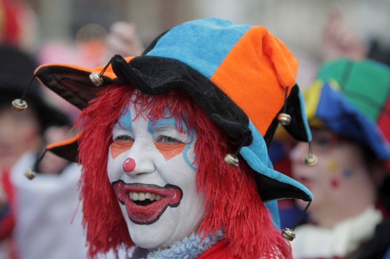 A fool is pictured during the street carnival in Mainz, western Germany on February 7, 2013. Hundreds of thousands of Germans, mainly in the western Rhine region, crowd the streets to celebrate Women's Carnival Day. (Fredrik Von Erichsen/Getty Images)
