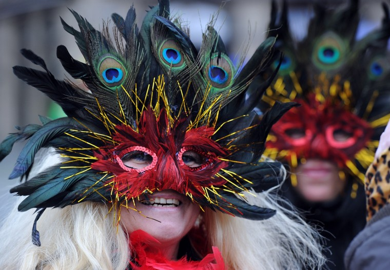 Fools celebrate the beginning of the street carnival in Duesseldorf, western Germany on February 7, 2013. Hundreds of thousands of Germans, mainly in the western Rhine region, crowd the streets to celebrate Women's Carnival Day. (Henning Kaiser/Getty Images)