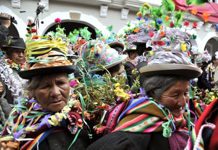 "Indigenous members of the Orinoca community dance a ""mexenada"" during the first day of the Andean Carnival in Oruro, Bolivia, on february 7, 2013. (Aizar Raldes/Getty Images)"
