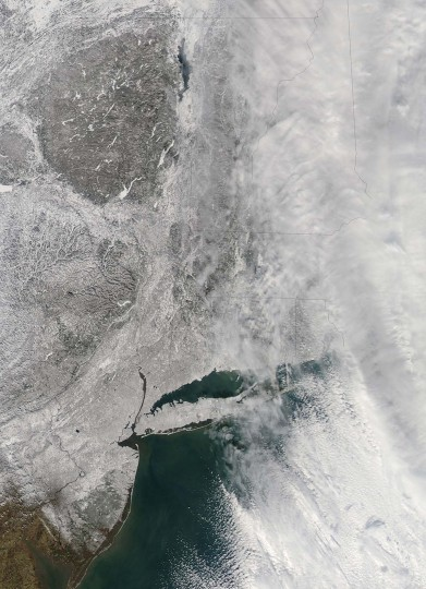This February 9, 2013 handout image provided by NASA, shows snow covering the northeastern US. The US northeast slowly dug out early Sunday from a mammoth blizzard that choked air, road and rail travel, left some 650,000 homes and businesses without power and caused at least seven deaths. New York and Long Island can be seen in the lower half of the image. (NASA HO/AFP/Getty Images)