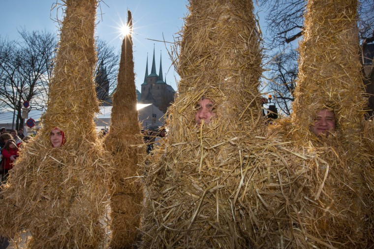 Fools dressed as straw dolls celebrate in the streets of Erfurt, eastern Germany, on February 10, 2013. Hundreds of thousands of people, mainly in the western Rhine region, crowd the streets to celebrate Carnival . (Michael Reichel/Getty Images)