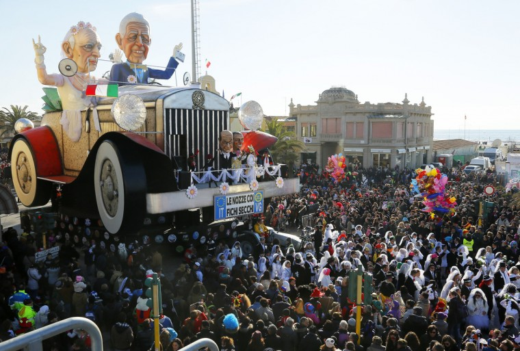 A float featuring Giant masks of political leaders Giorgio Napolitano and Mario Monti parades during the carnival in Viareggio on February 10, 2013. The carnival of Viareggio runs from February 3 to March 3, 2013 with parades of floats and masks, depicting caricatures of popular people, such as politicians, showmen and sportsmen. (Fabio Muzzi/Getty Images)
