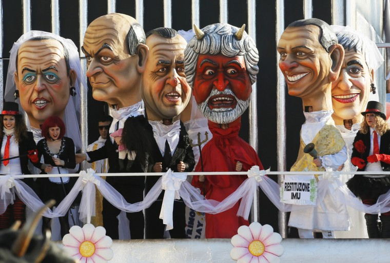 (From L) A float featuring Giant masks of political leaders Angelino Alfano, Luigi Bersani, Antonio Di Pietro, Beppe Grillo (devil), Silvio Berlusconi and Niki Vendola parades during the carnival in Viareggio on February 10, 2013. The carnival of Viareggio runs from February 3 to March 3, 2013 with parades of floats and masks, depicting caricatures of popular people, such as politicians, showmen and sportsmen. (Fabio Muzzi/Getty Images)
