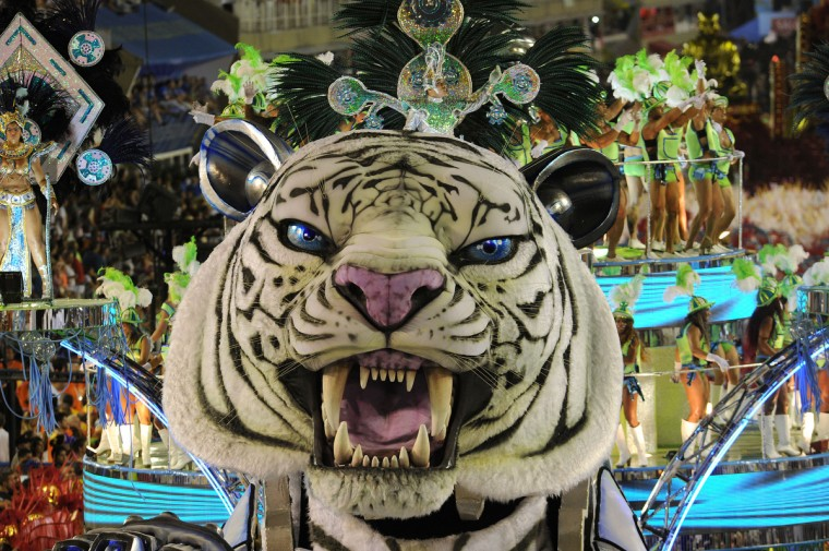 Revelers of the Inocentes de Belford-Roxo samba school perform during the first night of Carnival parade at the Sambadrome in Rio de Janeiro, Brazil on February 10, 2013. Inocentes pays tribute to the 50th aniversary of South Korean immigration to Brazil. (Antonio Scorza/Getty Images)
