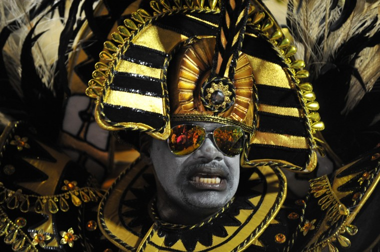 A reveler of Academico do Salgueiro samba school performs during the first night of Carnival parade at the Sambadrome in Rio de Janeiro on February 10, 2013. (Vanderlei Almeida/Getty Images)