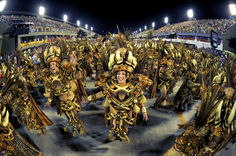 Revelers of Academico do Salgueiro samba school perform during the first night of Carnival parade at the Sambadrome in Rio de Janeiro on February 10, 2013. (Cristophe Simon/Getty Images)