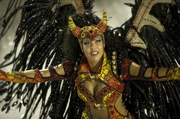 A reveler of Unidos da Tijuca samba school performs during the first night of Carnival parade at the Sambadrome in Rio de Janeiro, Brazil. (Antonia Scorza/Getty Images)