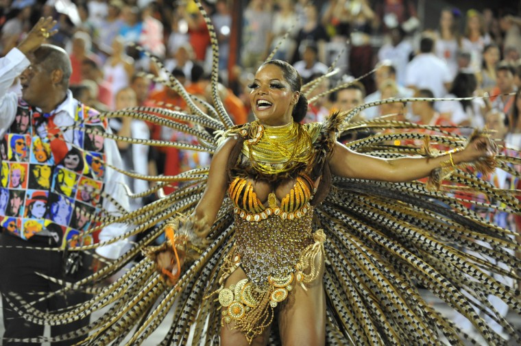 A reveler of the Academico do Salgueiro samba school performs during the first night of Carnival parade at the Sambadrome in Rio de Janeiro on February 10, 2013. (Vanderlei Almeida/Getty Images)