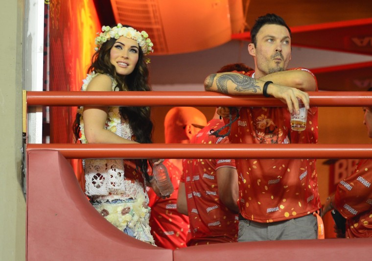 US actress Megan Fox (L) looks at Unidos da Tijuca samba school during the first night of Carnival parade at the Sambadrome in Rio de Janeiro on February 11, 2013. (Cristophe Simon/Getty Images)
