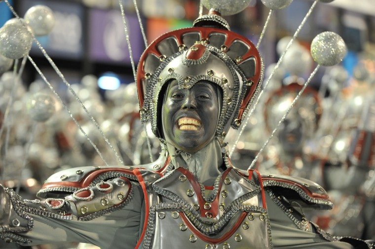 A reveler of Unidos da Tijuca samba school performs during the first night of Carnival parade at the Sambadrome in Rio de Janeiro on February 11, 2013. (Vanderlei Almeida/Getty Images)