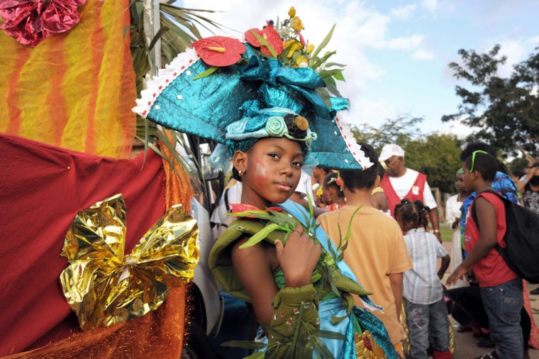 """Mini Queen of Martinique"" poses during the Carnival parade in the streets of Fort-de-France on the French Caribbean island of Martinique. The Carnaval started on February 9, 2013 and will run until Ash Wednesday on February 13, 2013 when Vaval, a giant papier-mache figure symbolizing the king of the carnival, is burned. (Jean-Michel Andre/Getty Images)"