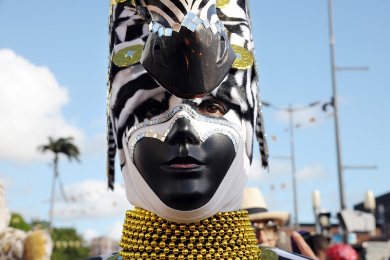 A reveler poses during the Carnival parade in the streets of Fort-de-France on the French Caribbean island of Martinique, on February 10, 2013. The Carnaval started on February 9, 2013 and will run until Ash Wednesday on February 13, 2013 when Vaval, a giant papier-mache figure symbolizing the king of the carnival, is burned. (Jean-Michel Andre/Getty Images)