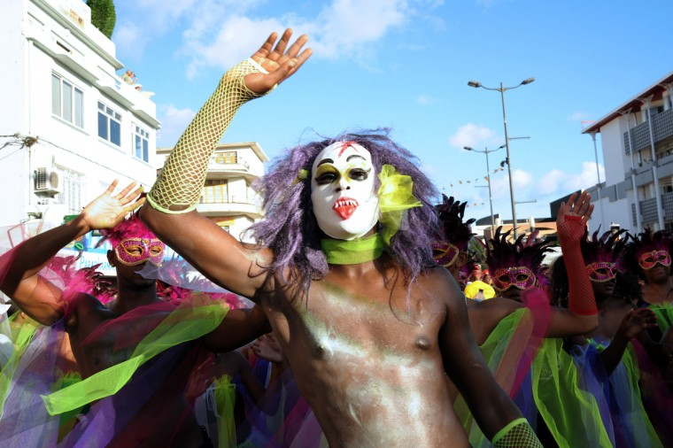 Revelers pose during the Carnival parade in the streets of Fort-de-France on the French Caribbean island of Martinique, on February 10, 2013. The Carnaval started on February 9, 2013 and will run until Ash Wednesday on February 13, 2013 when Vaval, a giant papier-mache figure symbolizing the king of the carnival, is burned. (Jean-Michel Andre/Getty Images)