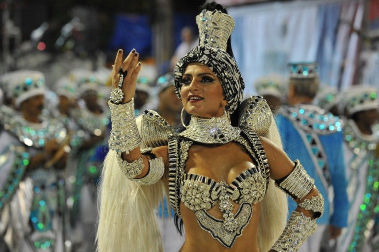 A reveler of Uniao da Ilhia samba school performs during the first night of Carnival parade at the Sambadrome in Rio de Janeiro on February 11, 2013. (Vanderlei Almeida/Getty Images)