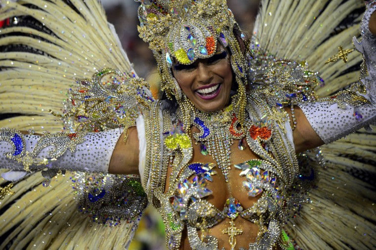 A reveler of Portela samba school performs during the first night of Carnival parade at the Sambadrome in Rio de Janeiro on February 11, 2013. (Cristophe Simon/Getty Images)