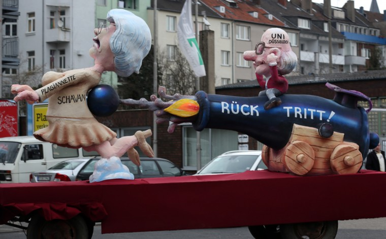 A theme float about the resignation of the German Education Secretary Annette Schavan is on its way at the Rose Monday parade in Duesseldorf, Germany, on February 2013. (Martin Gerten/Getty Images)