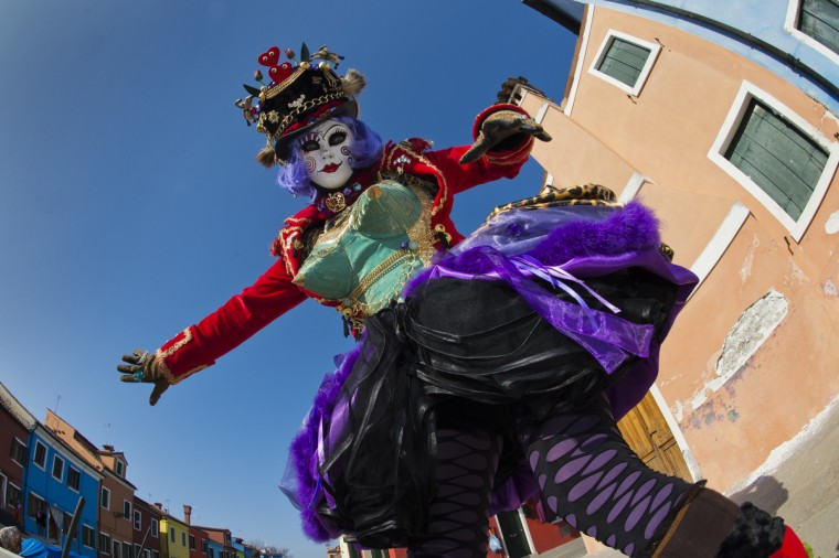 "A costumed reveller poses during the carnival on February 10, 2013 in Venice. The 2013 edition of the Venice carnival is untitled "" Live in Colour"" and runs from January 26 to February 12. (Getty Images)"