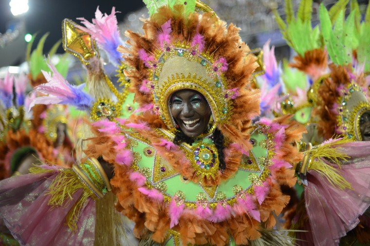 Revelers of Mangueira samba school perform during the second night of Carnival parades at the Sambadrome in Rio de Janeiro on February 11, 2013. (Christophe Simon/Getty Images)