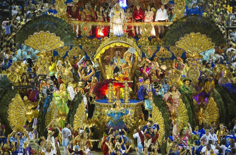 Revelers of Beija Flor samba school perform during the second night of Carnival parade at the Sambadrome in Rio de Janeiro, Brazil on February 11, 2013. (Antonio Scorza/Getty Images)