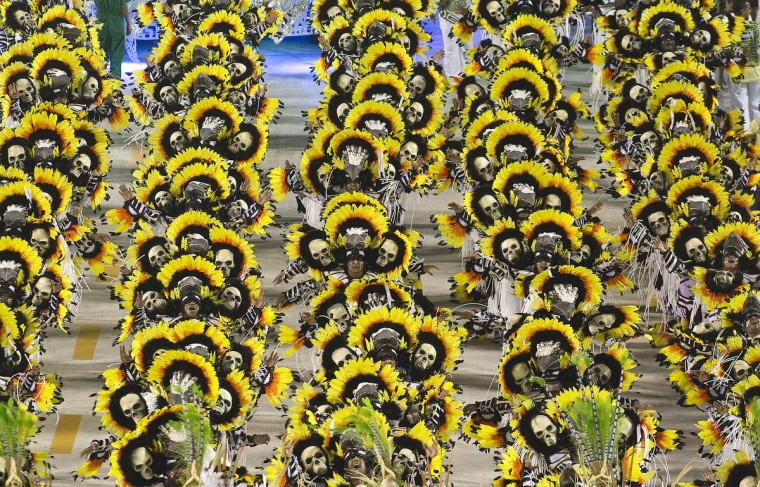 Revelers of Imperatriz Leopoldinense samba school perform during the second night of Carnival parade at the Sambadrome in Rio de Janeiro, Brazil on February 12, 2013. (Antonio Scorza/Getty Images)