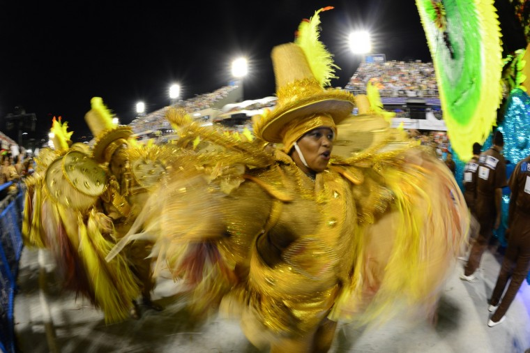 Revelers of Imperatriz Leopoldinense samba school perform during the second night of Carnival parades at the Sambadrome in Rio de Janeiro on February 12, 2013. (Christophe Simon/Getty Images)