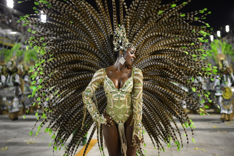 A reveler of Imperatriz Leopoldinense samba school performs during the second night of Carnival parades at the Sambadrome in Rio de Janeiro on February 12, 2013. (Christophe Simon/Getty Images)