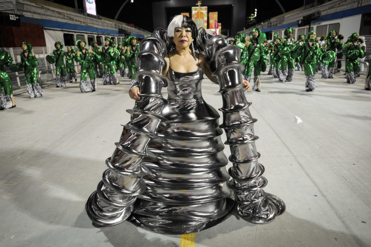 Japanese avant-garde fashion designer Junko Koshino performs with her designed costume for Barroca Zona Sul samba school during the last day of the carnival parades at the Sambadrome in Sao Paulo, Brazil, on February 12, 2013. Barroca this year is focusing its carnival theme on the history of Jabaquara, an ethnically diverse district that includes Jardim Oriental, a community that is home to many Japanese. (Yasuyoshi Chiba/Getty Images)
