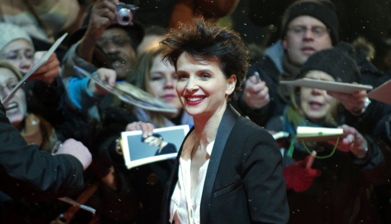 "French actress Juliette Binoche arrives on the red carpet prior to the screening of the film ""Camille Claudel 1915"" presented in the Berlinale Competition of the 63rd Berlin International Film Festival in Berlin. (John Macdougal/Getty Images)"