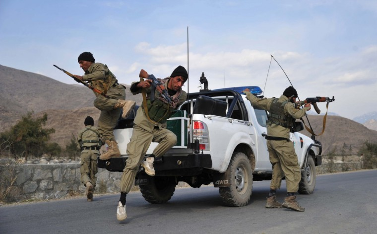 Afghan Local Police (ALP) personnel jump from their vehicle as they patrol in Nor Gal district Kunar province. The Afghan government welcomed President Barack Obama's announcement that the United States will withdraw 34,000 troops from the war-torn country over the next year. NATO, which has about 37,000 troops in Afghanistan, will also withdraw them in stages before the end of 2014. (Noorullah Shirzada/Getty Images)