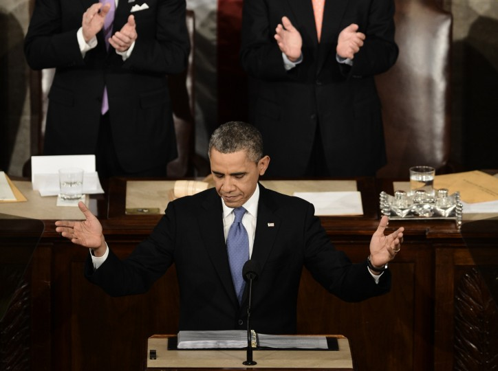 US President Barack Obama acknowledges applause before delivering his annual State of the Union address to a joint session of Congress at the US Capitol in Washington. (Paul J. Richards/Getty Images)