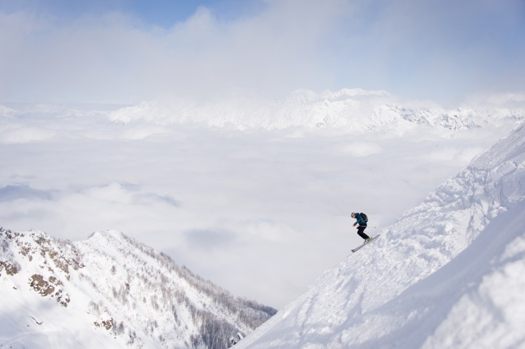 A skier sets off from the peak of Mount Aigba in the Rosa Khutor Extreme Park, some 50 km from Russia's Black Sea resort of Sochi. With a year to go until the Sochi 2014 Winter Games, construction work continues as tests events and World Championship competitions are underway. (Leon Neal/Getty Images)