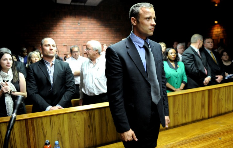 South African Olympic sprinter Oscar Pistorius (C) appears at the Magistrate Court in Pretoria as he father Henke (3rd L), brother Carl (2nd L) and sister Aimee (L) attend. Pistorius battled to secure bail as he appeared on charges of murdering his model girlfriend Reeva Steenkamp on February 14, Valentine's Day. South African prosecutors will argue that Pistorius is guilty of premeditated murder in Steenkamp's death, a charge which could carry a life sentence. (Stephane De Sakutin/Getty Images)