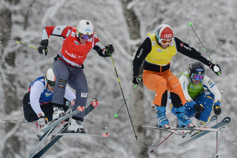 Canadian Christopher Delbosco (L) races during Ski Cross final race at the Snowboarding and Free Style World Cup Test Event at the Snowboard and Free Style Center in Rosa Khutor near the Russian Black Sea resort of Sochi. Swedish Victor Oehling Norberg won ahead of Canadian Christopher Delbosco and German Andreas Schauer. (Natalia Kolesnikova/Getty Images)