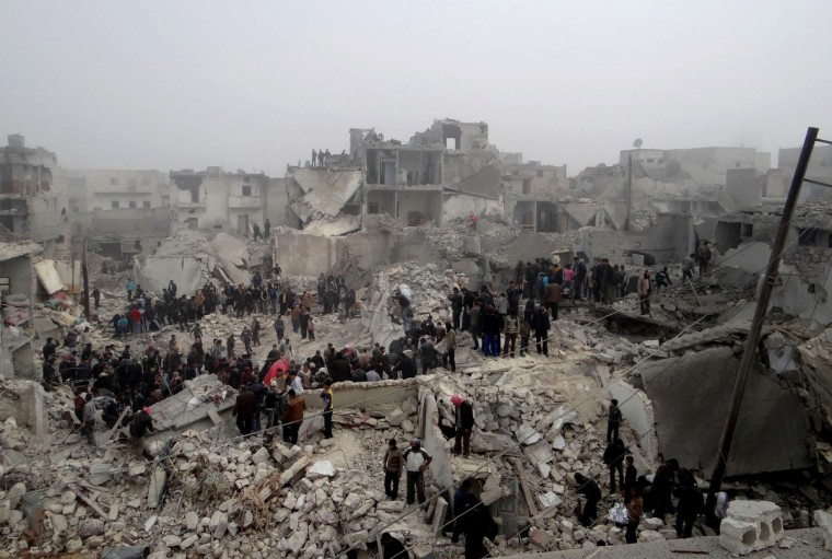 Syrians inspect destruction following an apparent surface-to-surface missile strike on the northern Syrian city of Aleppo. Six children were among at least 19 people killed in an apparent surface-to-surface missile strike on the northern Syrian city of Aleppo late on February 18, the Syrian Observatory for Human Rights said. (Getty Images)