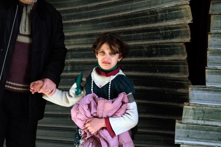 A Syrian girl cries following an explosion in the northern city of Aleppo. The UN says at least 70,000 people have been killed in the near two-year conflict, and puts the number of Syrians who have fled their homeland at more than 850,000. (Mauricio Morales/Getty Images)