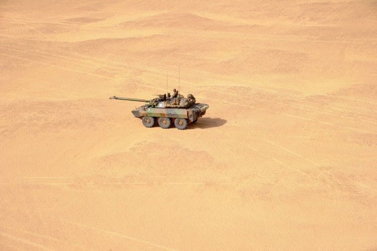 A French soldier drives an armoured vehicle in the desert near Bourem, northern Mali. A French-led military intervention launched on January 11 has driven the Islamist rebels in Mali from the towns they controlled, but concerns remain over stability amid suicide attacks and guerrilla fighting. (Pascal Guyot/Getty Images)