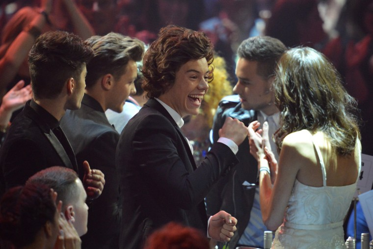 Harry Styles (C), Zayn Malik, Liam Payne, Louis Tomlinson, and Niall Horan of British-Irish pop band One Direction celerbate after their win of the Global Sucess award is announced during the BRIT Awards 2013 ceremony in London. (Ben Stansall/Getty Images)