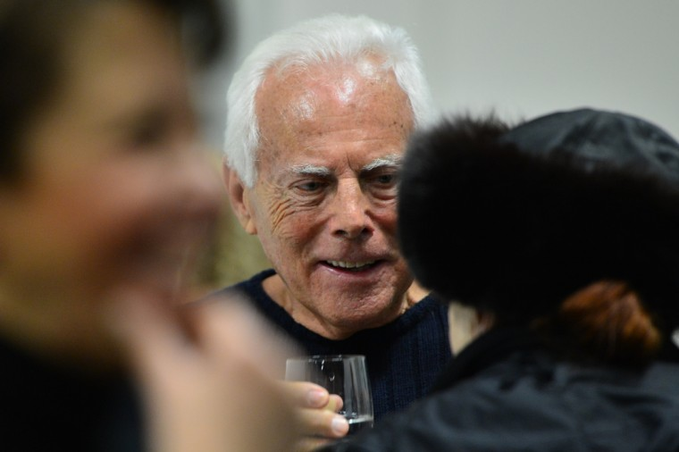 Italian designer Giorgio Armani chats backstage after the Emporio Armani Fall-Winter 2013-2014 Womenswear collection during the Women's fashion week in Milan. (Gabriel Bouys/Getty Images)