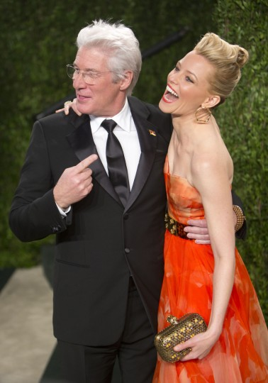 Richard Gere and Elizabeth Banks (R) arrive for the 2013 Vanity Fair Oscar Party on February 24, 2013 in Hollywood, California following the 85th Academy Awards ceremony. (Adrian Sanchez-Gonzalez/Getty Images)