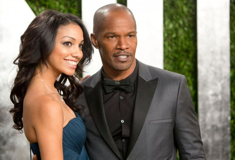 Jamie Foxx and his daughter arrive for the 2013 Vanity Fair Oscar Party on February 24, 2013 in Hollywood, California. (Adrian Sanchez-Gonzalez/Getty Images)