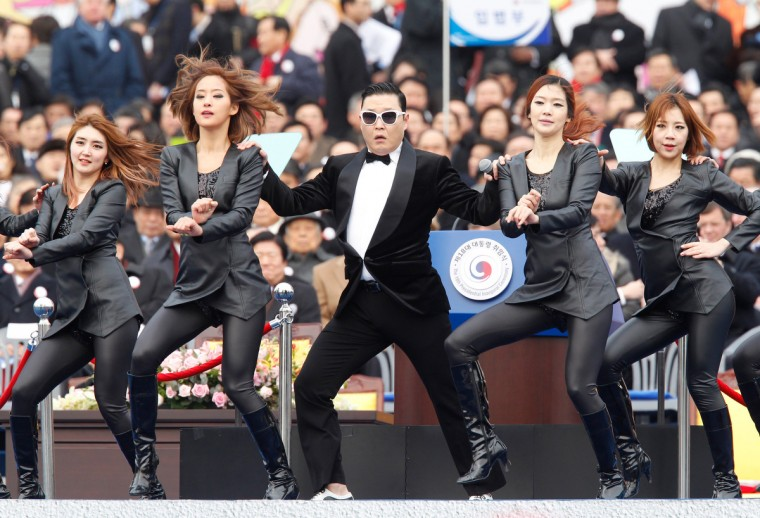 """Singer Psy (C) performs during the inauguration ceremony of South Korea's new President Park Geun-Hye at parliament in Seoul. Park Geun-Hye became South Korea's first female president on February 25, vowing zero tolerance with North Korean provocation and demanding Pyongyang """"abandon its nuclear ambitions"""" immediately. (Kim Hong-Ji/Getty Images)"""