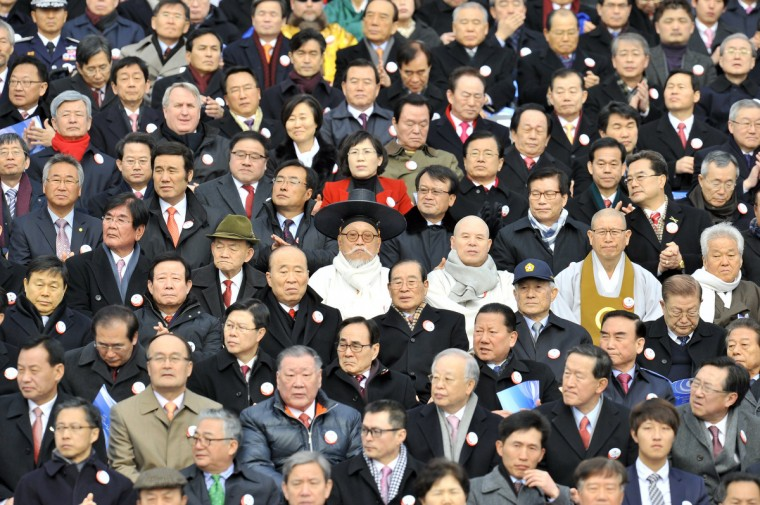 A South Korean elderly man (C) wearing a traditional scholar outfit sits during the presidential inauguration ceremony for South Korea's incoming president Park Geun-Hye at the National Assembly in Seoul. Park Geun-Hye was sworn in as South Korea's first female president on February 25, vowing zero tolerance with provocations from a nuclearized North Korea and a new era of economic prosperity for all. (Jung Yeon-Je/Getty Images)