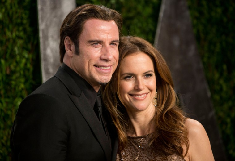 John Travolta and his wife Kelly Preston arrive for the 2013 Vanity Fair Oscar Party on February 24, 2013 in Hollywood, California. (Adrian Sanchez-Gonzalez/Getty Images)