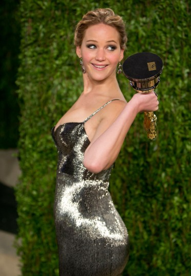 Jennifer Lawrence carrying her Oscar for best actress arrives for the 2013 Vanity Fair Oscar Party on February 24, 2013 in Hollywood, California. (Adrian Sanchez-Gonzalez/Getty Images)