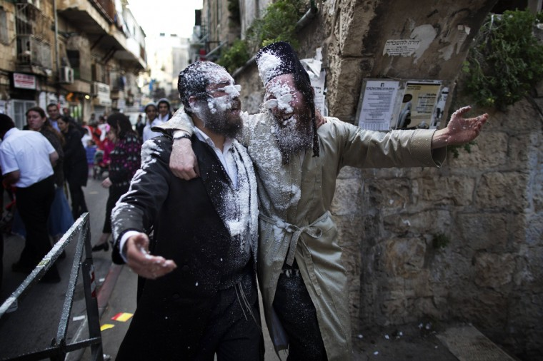 Ultra-Orthodox Jews celebrate the Jewish festival of Purim in the religious neighborhood of Mea Shearim in Jerusalem. Purim marks the deliverance of the Jewish people from a genocidal plot in ancient Persia, as recorded in the Biblical Book of Esther. (Menahem Kahana/Getty Images)