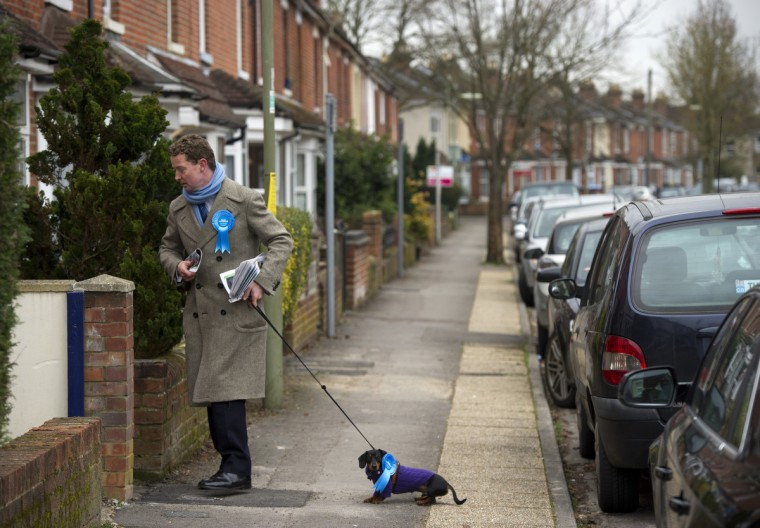 British Conservative MP Gregory Barker and his dog Otto canvas for votes on behalf of his party's candidate for the Eastleigh by-election, Maria Hutchings, in southern England. A by-election in Eastleigh was triggered by the resignation of former Liberal Democrat Cabinet Minister Chris Huhne, who earlier this month admitted perverting the course of justice. The by-election will be held on Thursday February 28, 2013. (Adrian Dennis/Getty Images)