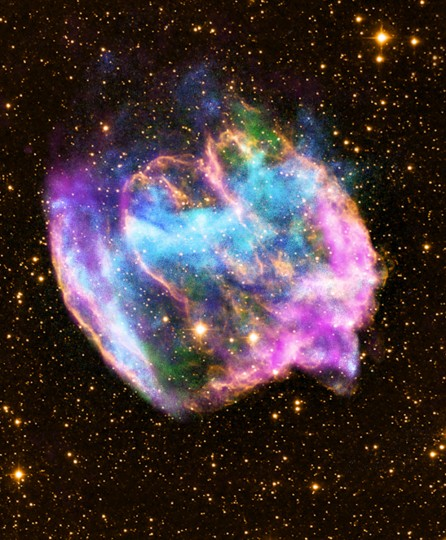 This NASA Chandra X-Ray Observatory image shows a highly distorted supernova remnant that may contain the most recent black hole formed in the Milky Way galaxy. The composite image combines X-rays from Chandra (blue and green), radio data from the Very Large Array (pink), and infrared data from the Palomar Observatory (yellow). Most supernova explosions that destroy massive stars are generally symmetrical. In the W49B supernova, however, it appears that the material near its poles was ejected at much higher speeds than that at its equator. There is also evidence that the explosion that produced W49B left behind a black hole and not a neutron star like most other supernovas. (NASA)