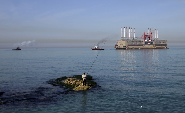 Karadeniz Powership Fatmagul Sultan docks at the newly set wave breaker in front of Lebanon's main electricity plant of Zouk. A member of Karadeniz Holding's powership fleet, Fatmagul Sultan, arrived in Beirut to supply Lebanon with electricity. (Joseph Eid/Getty Images)