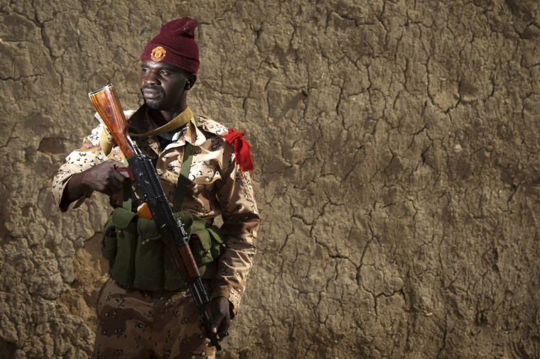 Malian Army soldier Seydou Couilibaly, 30, poses in the northern city of Gao. French and Malian government forces reconquered on January 26 the city opf Gao, two weeks after Paris launched an offensive in the north. (Joel Sagat/Getty Images)