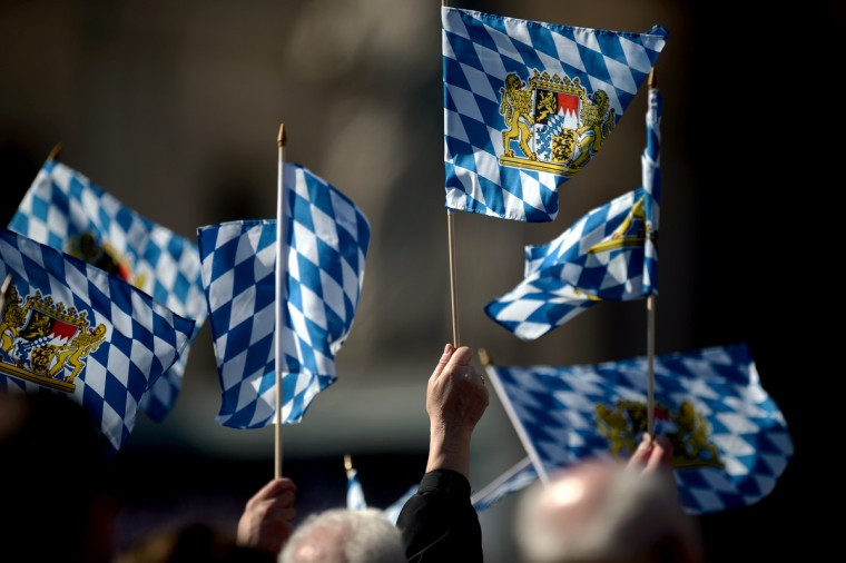 Faithful waves flags from Bavaria during Pope Benedict XVI's last weekly audience on February 27, 2013 at St Peter's square at the Vatican. Pope Benedict XVI will hold the last audience of his pontificate in St Peter's Square on Wednesday on the eve of his historic resignation as leader of the world's 1.2 billion Catholics. (Filippo Monteforte/Getty Images)